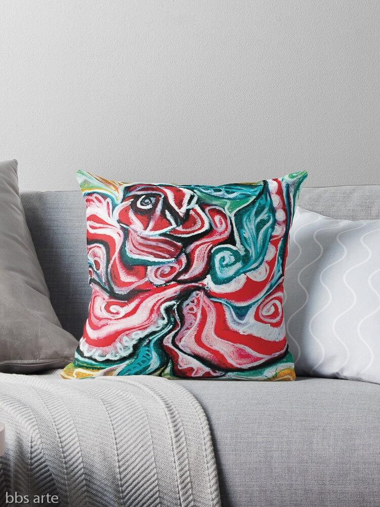 cuscino da divano con design natalizio astratto in toni di rosso, verde, bianco, nero e giallo su sfondo bianco