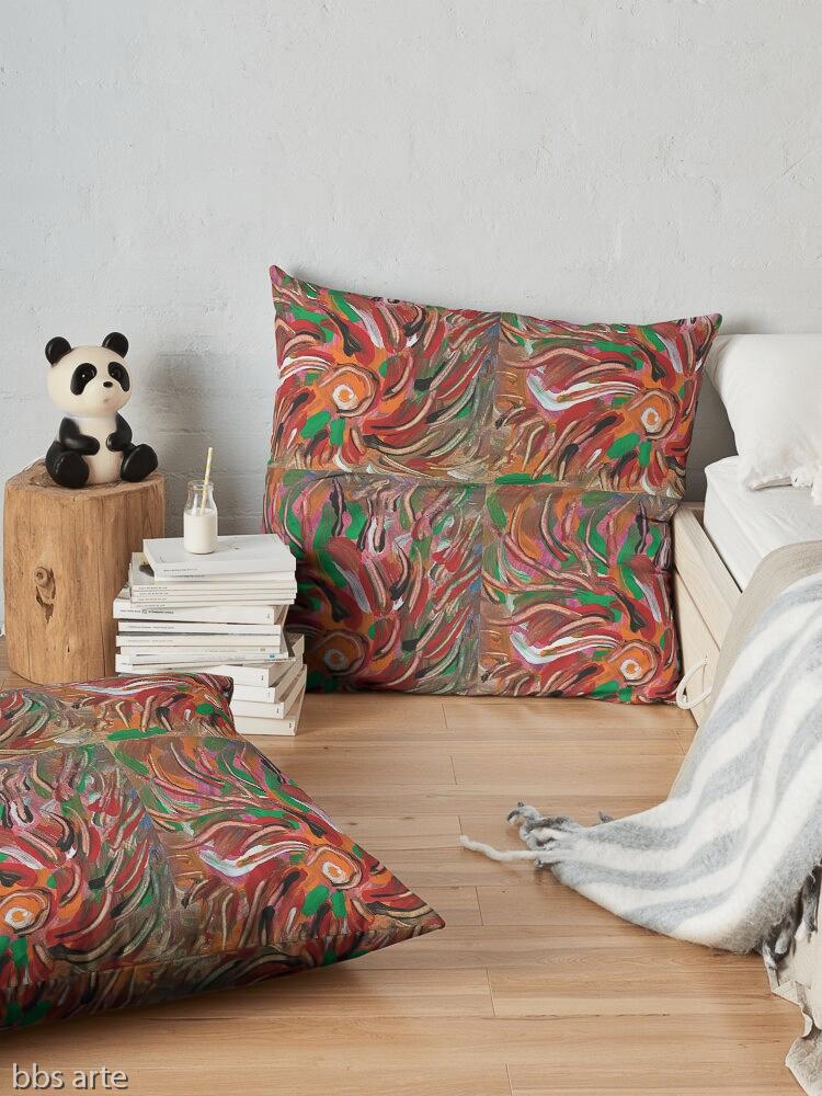 cuscino da pavimento con motivo astratto di vortice fiammante dai toni di rosso, verde, bianco, nero, arancione e marrone